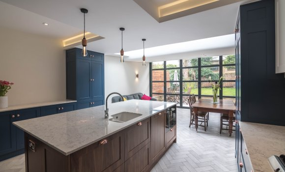Refurbishment kitchen with dark blue, brown furnitures and marble countertop