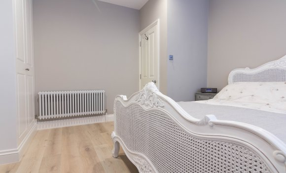 Completely refurbished bedroom with double bed and radiator
